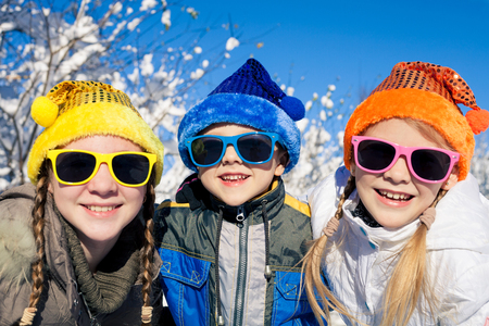 winter holiday: Cute little children playing  in winter snow day. People having fun outdoors. Concept Brother And Sister Together Forever and Happy new year. Stock Photo