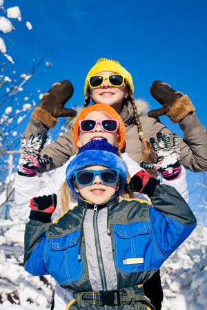 Cute little children playing  in winter snow day. People having fun outdoors. Concept Brother And Sister Together Forever and Happy new year. Stok Fotoğraf