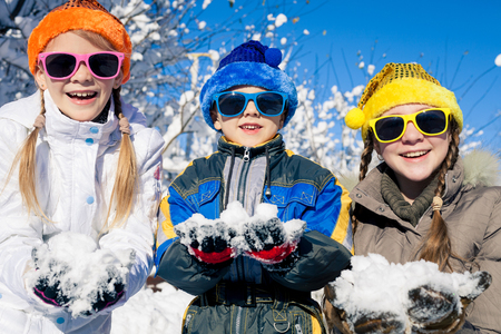 Cute little children playing  in winter snow day. People having fun outdoors. Concept Brother And Sister Together Forever and Happy new year. Archivio Fotografico