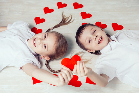 little boy and girl lying on the floor. Concept of happy Valentine day and Brother And Sister Together Forever