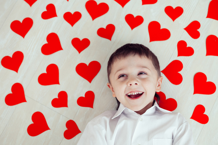 One little boy lying on the floor. Concept of happy Valentine day. Stock Photo