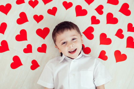 little one: One little boy lying on the floor. Concept of happy Valentine day. Stock Photo