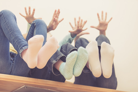 happy children which are sitting on the stairs in the house. The concept of a brother and sister forever. Stock Photo