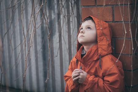 Portrait of sad little boy outdoors at the day time Banco de Imagens