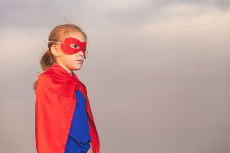 red and blue: Happy little child playing superhero