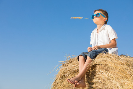 Happy little boy playing  in the park at the day time. Kid having fun outdoors. Concept of summer vacation. Stockfoto