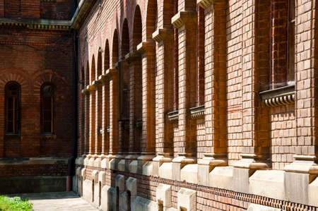 beautiful historical building of Chernivtsi national university religious seminary of red brick facade with blue sky sunny outdoor in Ukraine Stock Photo