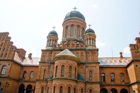campus tour: beautiful historical building of Chernivtsi national university religious seminary of red brick facade with blue sky sunny outdoor in Ukraine Editorial