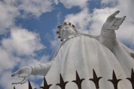 mary virgin monument in lebanon named harissa on blue sky background. lady of lebanon statue