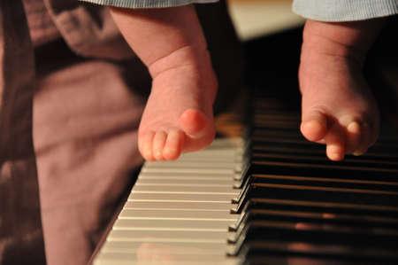 little genius. small kid musician play piano Imagens