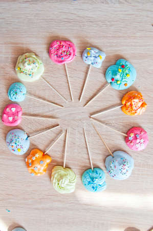 Ferris wheel of clock roung shape of meringue. french meringue on candy stick. confectionary and cafe. master class on decoration. geometry shape study with kids. mock up dessert background.