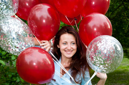 Always young at heart. happy woman with party birthday baloons outdoor in summer. Stock Photo - 103431384
