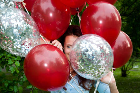 happy woman with party birthday baloons outdoor in summer. True happiness. Stock Photo