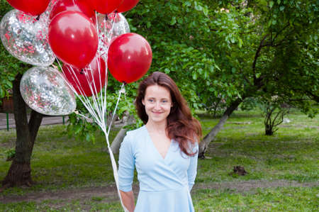 Happy birthday to me! happy woman with party birthday baloons outdoor in summer Stock Photo - 103431418