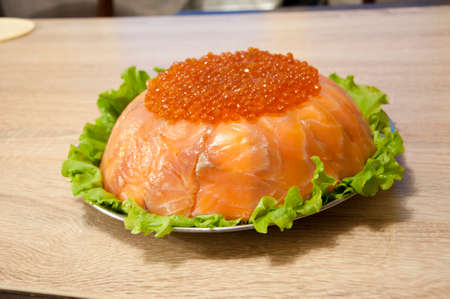 caviar with red fish - seed or trout on green lettuce salad as side dish. healthy food and culinary. cuisisne. dieting and eating. molecular kitchen? delicacy and luxury. restaurant serving. Stock Photo - 103431430