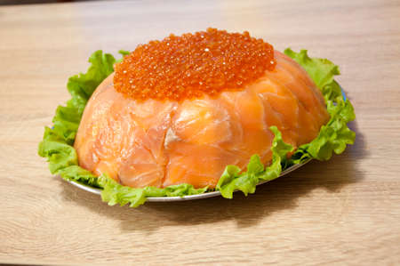 caviar with red fish - seed or trout on green lettuce salad as side dish. healthy food and culinary. cuisisne. dieting and eating. molecular kitchen? delicacy and luxury. restaurant serving. Stock Photo - 103431431