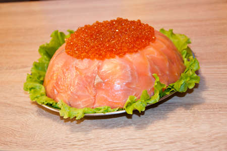 caviar with red fish - seed or trout on green lettuce salad as side dish. healthy food and culinary. cuisisne. dieting and eating. molecular kitchen? delicacy and luxury. restaurant serving. Stock Photo