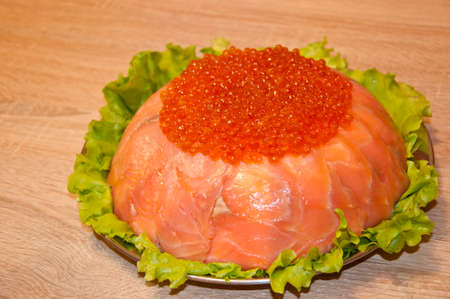 caviar with red fish - seed or trout on green lettuce salad as side dish. healthy food and culinary. cuisisne. dieting and eating. molecular kitchen? delicacy and luxury. restaurant serving. Stock Photo - 103431519