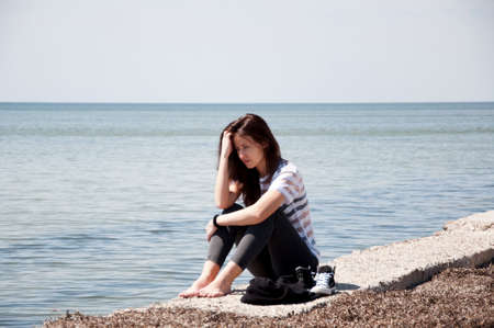 loneliness and thinking about future. waiting for better time. woman relax on sea shore. summer holiday and vacation. sea travel of stylish girl Stock Photo - 103285898