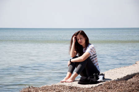 woman relax on sea shore. summer holiday and vacation. sea travel of stylish girl. loneliness and thinking about future. waiting for better time. Stock Photo - 103285899