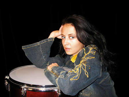 drum school. drum kit. musical instruments. lets play rock music. jeans jacket with gold. sexy woman drummer isolated on black. learn drumming. music is my life. Sexy rock girl singer has fashion look Stock Photo