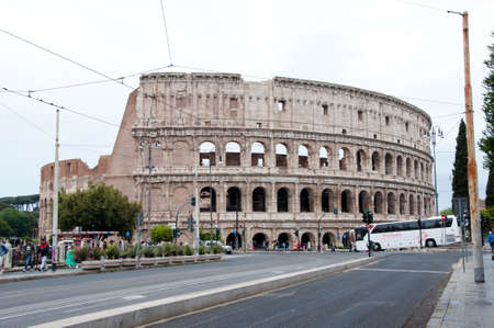 Rome, Italy - May 01, 2018: Coliseum architecture in Rome with tourists. Traveling and vacation in Europe, European Union. Coliseum is historical building. Destination place - Coliseum. Eternal City