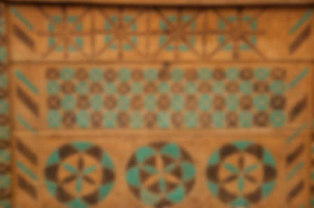 Flooring design. Wooden floor with blurring filter. Blurred wooden background. Blur wooden surface. Wood planked decor. Old decorative parquet. Geometric mosaic of wood pieces. Decoration in flooring. Stock Photo