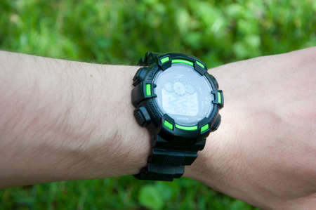 Time is life. Digital watch on male hand. Smart watch on natural background. Time management and accuracy. Smart watch with large screen. Fitness watch for outdoor activities. Modern digital gadget.