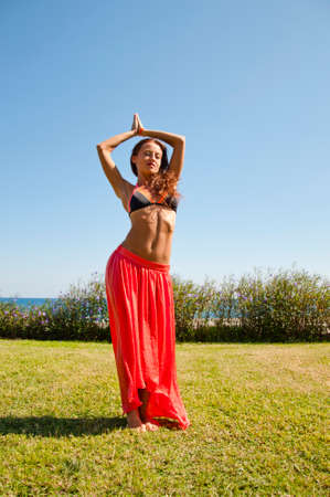 Summer vacation and travel. Perfect body of belly dancer. Suntan. Woman dancing with sexy body. Sexy woman with fit belly. Spa and relax. Sensual girl on sea beach. Eastern beauty. Beauty and fashion.