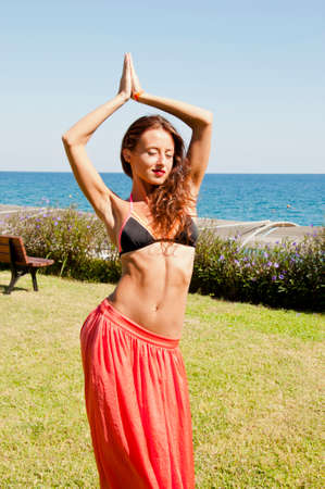 Extremely sexy. Summer vacation and travel. Perfect body of belly dancer. Suntan. Woman dancing with sexy body. Sexy woman with fit belly. Spa and relax. Sensual girl on sea beach. Eastern beauty.
