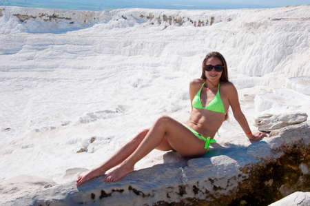 Pure beauty. Dead sea salty shore. Sexy girl. Cotton castle in southwestern Turkey. Sexy woman with fit suntan body. Natural travertine pool terrace in Pamukkale. Summer vacation in Pamukkale.
