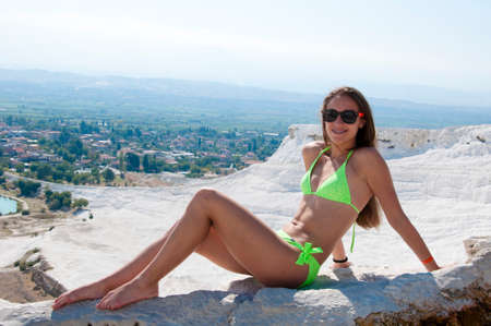 Feeling beautiful. Cotton castle in southwestern Turkey. Summer vacation in Pamukkale. Natural travertine pool terrace in Pamukkale. Dead sea salty shore. Sexy girl. Sexy woman with fit suntan body.