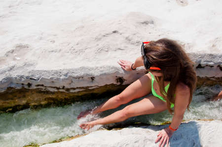 Summer vacation in Pamukkale. Sexy woman with fit suntan body. Cotton castle in southwestern Turkey. Dead sea salty shore. Sexy girl. Natural travertine pool terrace in Pamukkale. Massage therapy.