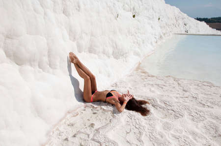 Never enough to be with her. Dead sea salty shore. Sexy girl. Summer vacation in Pamukkale. Natural travertine in Pamukkale. Beach life. Cotton castle in Turkey. Sexy woman with fit suntan body. Stock Photo