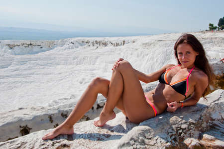 Better than any spa. Dead sea salty shore. Sexy girl. Cotton castle in southwestern Turkey. Summer vacation in Pamukkale. Natural travertine pool terrace in Pamukkale. Sexy woman with fit suntan body.