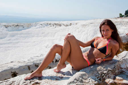 Cotton castle in southwestern Turkey. Natural travertine pool terrace in Pamukkale. Summer vacation in Pamukkale. Sexy woman with fit suntan body. Dead sea salty shore. Sexy girl. Relaxing in Jacuzzi. Standard-Bild