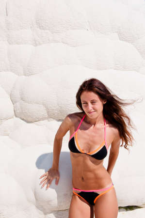 Fresh and beautiful. Sexy woman with fit suntan body. Cotton castle in southwestern Turkey. Summer vacation in Pamukkale. Dead sea salty shore. Sexy girl. Natural travertine pool terrace in Pamukkale.