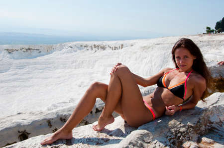 SPA serenity. Dead sea salty shore. Sexy girl. Cotton castle in southwestern Turkey. Natural travertine pool terrace in Pamukkale. Sexy woman with fit suntan body. Summer vacation in Pamukkale.