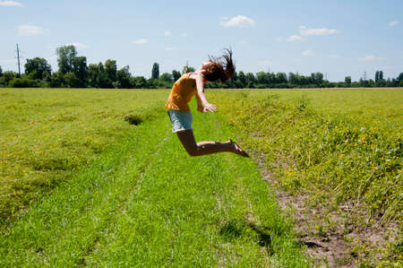 sense of freedom. happy girl jump high. full of happiness. fly away in dreams. summer activity of woman in field. sport and gymnastics. Foto de archivo