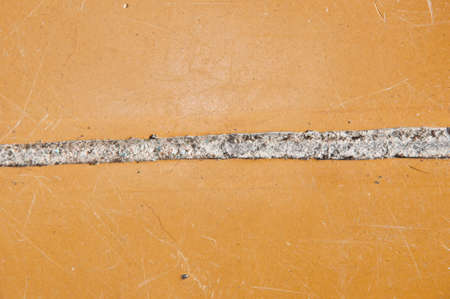Crack in linoleum floor. linoleum has come apart at the seam. hole in the floor. poor substandard floor covering. grunge background. flooring.
