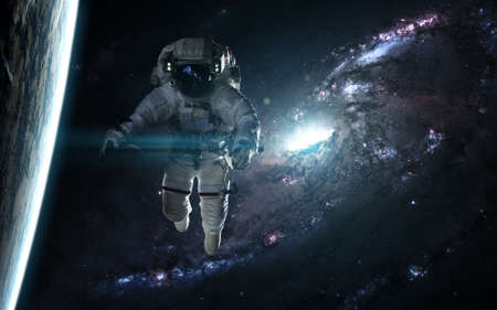 Astronaut and planet against a blue galaxy. Abstract science fiction. Image in 5K for desktop wallpaper. 写真素材