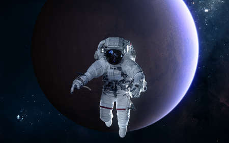 Astronaut on background of Mars. Solar system. Science fiction. Elements of this image furnished by NASA 写真素材