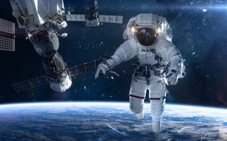 Astronaut, space station in deep space. Beautiful cosmic landscape. Science fiction. Elements of this image furnished by NASA