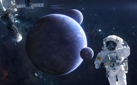 Astronaut and space station on background of deep space planets. Science fiction. Elements of this image furnished by NASA