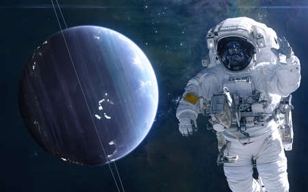 Uranus and astronaut. Solar system. Science fiction. Elements of this image furnished by NASA