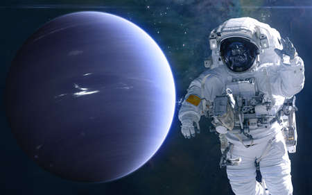 Neptune and astronaut. Solar system. Science fiction. Elements of this image furnished by NASA