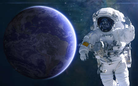 Earth and astronaut. Solar system. Science fiction. Elements of this image furnished by NASA