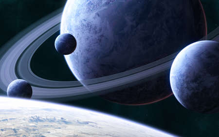 Blue planet with a system of rings and satellites in deep space. Science fiction.