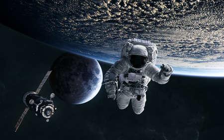 Astronaut, ISS in low Earth orbit. Moon. Solar system. Science fiction. Banco de Imagens