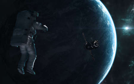 Astronaut, space station on background of planet of deep space in rays of a blue star. Science fiction.